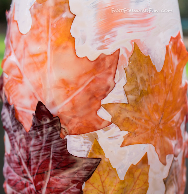 DIY Fall Leaf Candle Holder using mod podge and fake leaves!